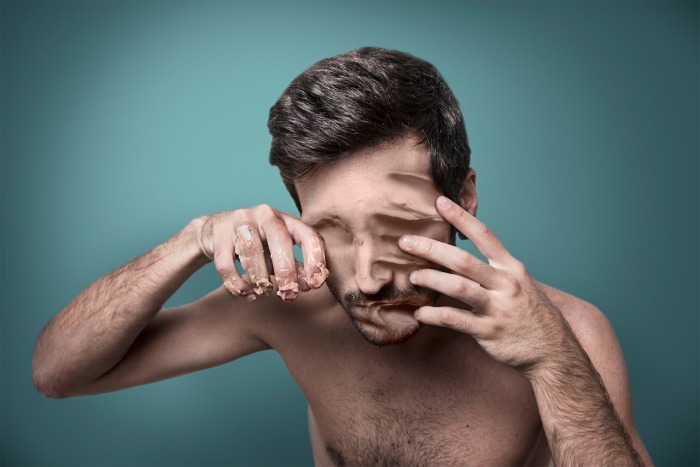 Surreal & Haunting Photographs Of A Man Trying To Erase His Face